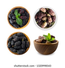 Set of mulberries. Mulberries in a wooden bowl with copy space for text. Black and purple mulberry on white background. Ripe and tasty mulberry isolated on white background. Top view.