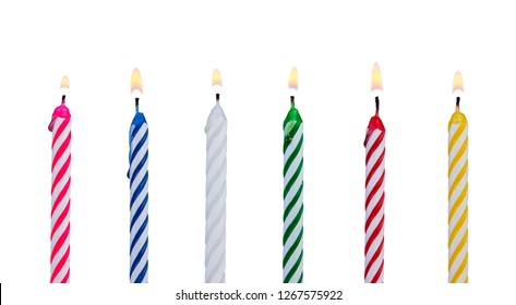 A set of multicolored candles for festive cupcake isolated on white background