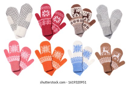 Set of multicolored knitted mittens. Warm woolen knitted mittens isolated on white background.