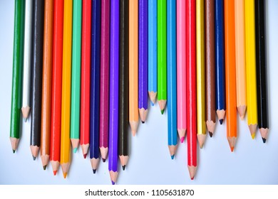 Set of multicoloured pencil or crayon on white background