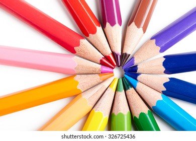 Set of multicoloured pencils lying on white table round order. Creativity, art skill and school, variety of possibilities, game of imagination and fantasy, make world vivid and impressive concept