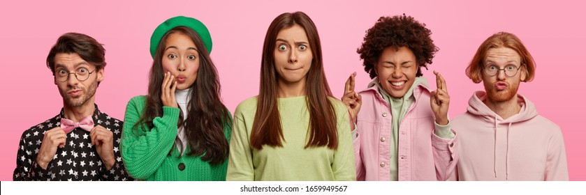 Set of multiethnic young people have different face expressions, express various emotions, pose closely to each other. Man adjustes bowtie, Asian lady in green outfit, Afro woman crosses fingers