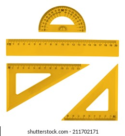 Set of multiple orange plastic rulers and the protractor, isolated over the white background