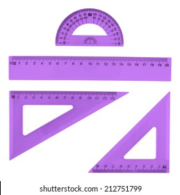 Set of multiple violet colored plastic rulers and the protractor, isolated over the white background