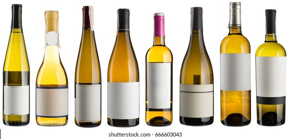 Set of multiple white wine bottles isolated on white