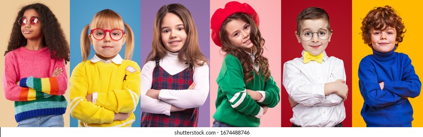 Set of multiracial confident children with arms crossed in trendy casual clothes smiling at camera while standing against vibrant background in studio