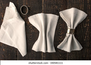 Set of the napkins with vintage ring on the wooden table horizontal