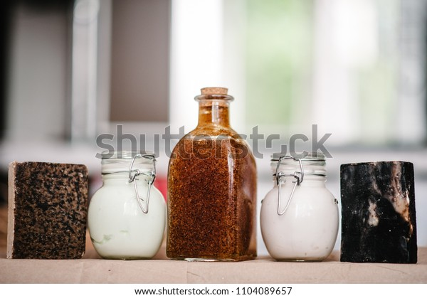A set of natural cosmetics of body care on shelf: soap, cream, jar shampoo, conditioner, shower gel, scrub, lotion isolated. Beauty treatment. The concept of skin care. Place for text and advertising.