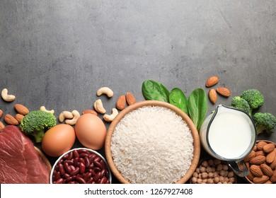 Set of natural food high in protein and space for text on grey background, top view