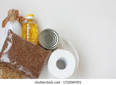 set of necessary products in quarantine period, cereals, milk, sunflower oil, canned food, pasta and toilet paper, gratuitous help, white background
