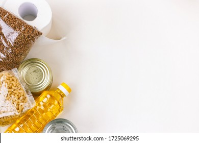 set of necessary products in quarantine period, cereals, sunflower oil, canned food, pasta and toilet paper, gratuitous help, white background