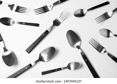 Set of new metal cutlery on white background, top view
