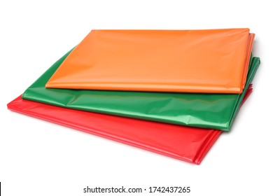 Set of new plastic tablecloths on white background