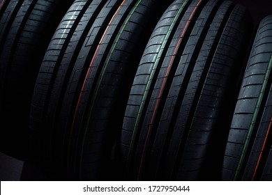 Set of new tires on a black background