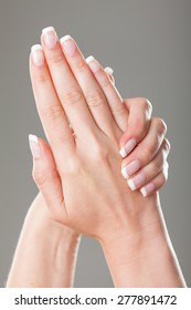 Set of nicely manicured fingernails with french manicure.