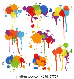 Set of nine different shapes of multicolored stains and blots in brightly colored ink  paint or pigment with drips and runs in an artistic display illustration