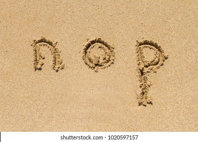 Set of nop letters of alphabet written on sand with lower case.