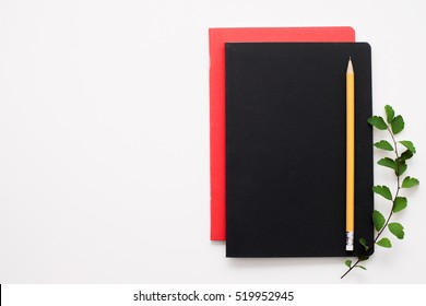 Set of notebooks on white background, free space. Writer work stuff, notebook and pencil. Artist, sketch drawing, article writing concept