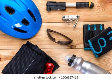 set of objects for cycling on wooden boards top view