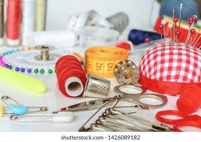 Set of objects for needlework: threads, needles, pins, scissors, beads, centimeter tape etc.