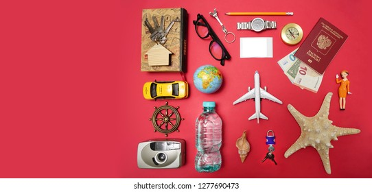 set of objects for travel isolated on red paper background.