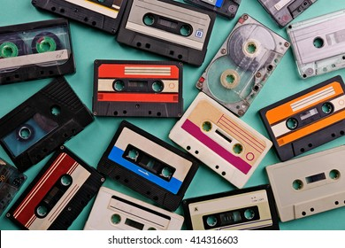 Set of old audio cassettes on blue background