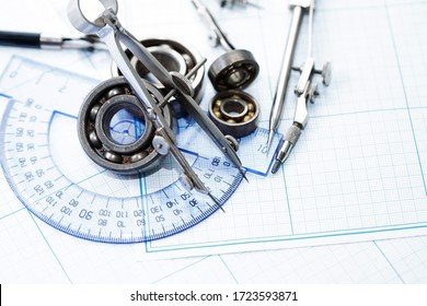 Set of old drawing tools on background with graph paper
