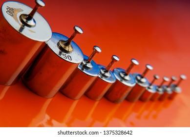 set of old kettlebells on an orange background. Close-up.