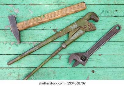 Set of old tools on wooden background. Construction concept