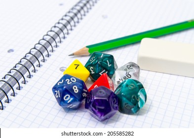 set of open exercise book, pencil, rubber and dices - stock photo