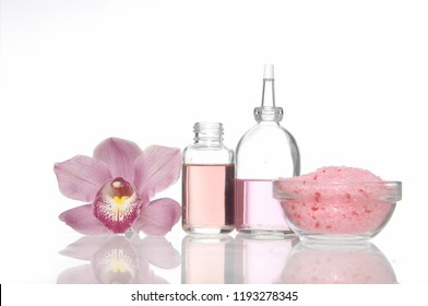 Set of orchid and massage oil , salt in bowl