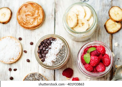 set overnight oats with berries, coconut, peanut butter, Chia seeds and chocolate chips. toning. selective focus