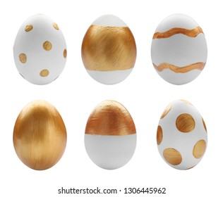 Set of painted golden Easter eggs on white background