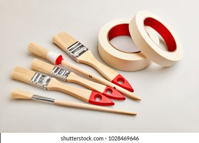 Set of painting brushes and masking tapes