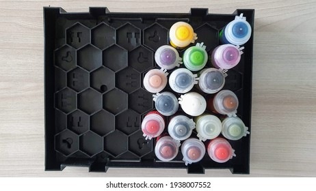 A set of paints for coloring models according to Warhammer 40 000.  A set of paints in a special stand for Warhammer paints.