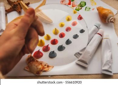 A set of paints, tubes of paint. Set the artist.
