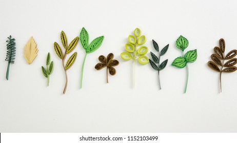 Set of Paper Leaves/ Quilled paper crafts with paper strips. Leaf art with papers isolated on white background.