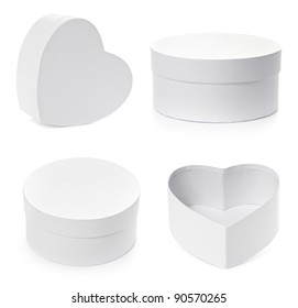 Set of pasteboard gift boxes isolated on white background with clipping path. Round and heart shape.