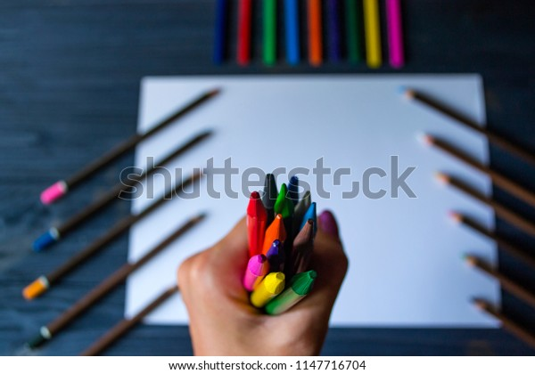 The set of pencils in the hand.