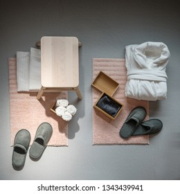 set of personal items in the hotel room, bathrobe, towel, slippers, top view
