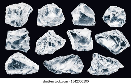 Set of pieces of crushed ice, isolated on black background,  Clipping path for each piece included.