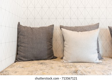 set of pillows on bench in living room design, interior design concept