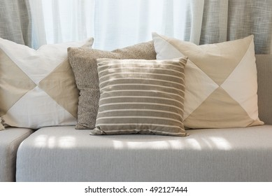 set of pillows on grey sofa in modern living room design