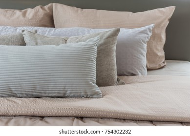 set of pillows on king bed size in luxury bedroom, interior design concept