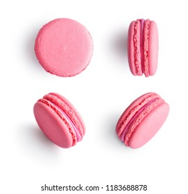 Set of pink french macarons isolated on white background. Top view.