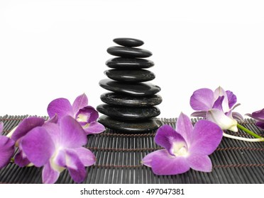 Set of pink orchid with black stones on mat
