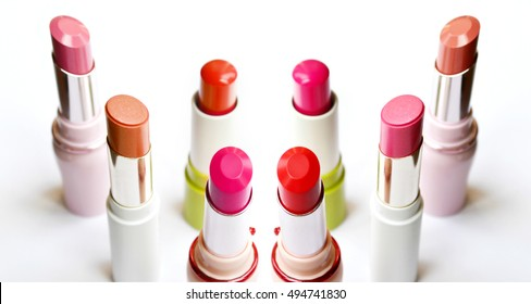 Set of pink and red lipsticks isolated on white