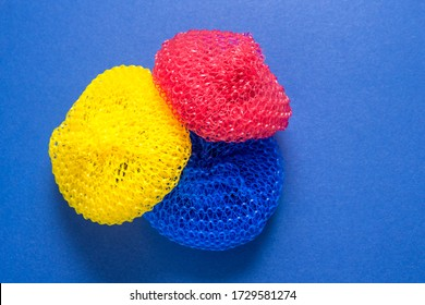 Set of plastic scrubbers, kitchen dish washer on color background