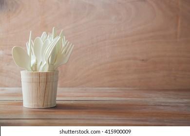 Set of plastic spoons on wood table