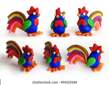 Set of plasticine cocks in different views. Modeling clay roosters isolated on white background. Chinese symbol of New Year 2017.